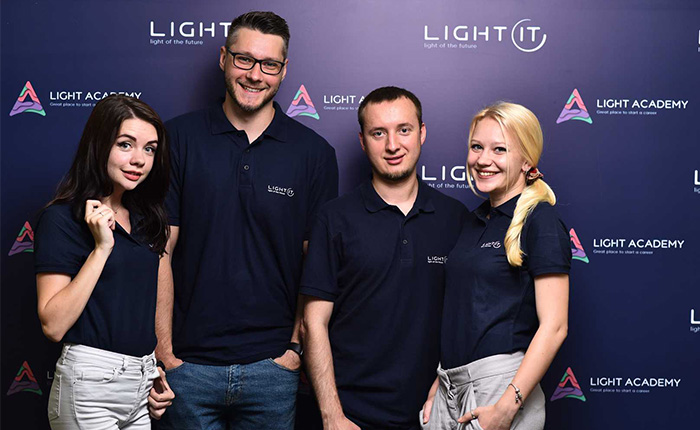 Four colleagues in corporate polo shirts