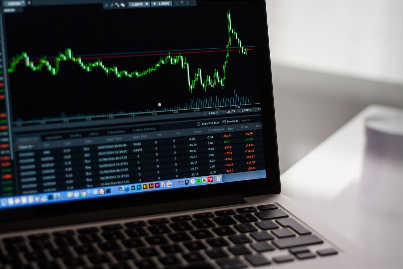 An asset price chart on a notebook screen