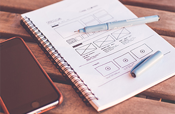 Web design drawing in notebook